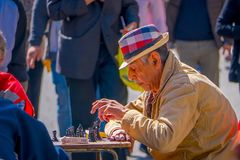 SANTIAGO, CHILE - SEPTEMBER 14, 2018: Unidentified man playing chess at outdoors in Plaza de Armas located in dowtown in. Santiago de Chile with blurred people Stock Images
