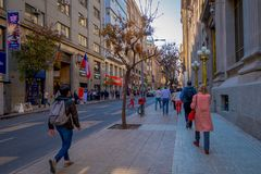 SANTIAGO, CHILE - SEPTEMBER 13, 2018: Unidentified people on the downtown street of the city. This area consists of 19th. Century neoclassical colonial stock images