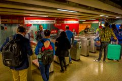 SANTIAGO, CHILE - SEPTEMBER 14, 2018: Unidentified people showing the ticket pass to enter to the metro station, located. At the Plaza de Armas in Santiago de Royalty Free Stock Image