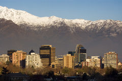 Santiago de Chile. Skyline of Providencia district in Santiago de Chile with snowed Andes mountain range in the background.  This is a wealthy residential and Stock Photo