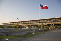 Santiago de Chile Airport. Santiago Airport at late evening with Chilean waving flag Royalty Free Stock Photos