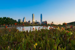 Santiago de Chile. Pond at Bicentennial Park in the wealthy Vitacura district and skyline of buildings at financial district, Santiago de Chile Royalty Free Stock Photography