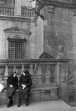 SANTIAGO DE COMPOSTELA, GALICIA, SPAIN – 1977. Two elderly women, dressed in a traditional way, seated converse near the Gothic Cathedral on August, 1977 in Royalty Free Stock Photos