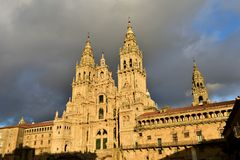 Cathedral with sunset light. Obradoiro Square, rainy day, grey sky. Baroque facade and towers, Santiago de Compostela, Spain. royalty free stock images