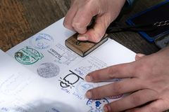 Santiago de Compostela, Spain; April 19, 2019; Pilgrim stamping a identification named The Compostela the accreditation of the stock image