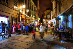 Santiago de Compostella by night. Nightshot of nightlife in street cafes and rambling people in the old town center of Santiago de Compostella, Galicia Royalty Free Stock Image
