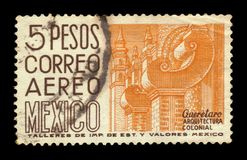 Santiago de Queretaro in Mexico. MEXICO - CIRCA 1951: a stamp printed in Mexico, shows cityscape of Queretaro - Colonial architecture, Mexico, circa 1951 royalty free stock image