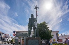 Sculpture of an ancient hunter in the center of the city against the blue sky. Santiago del Teide, Spain - March: Santiago del Teide is a municipality and a Royalty Free Stock Image