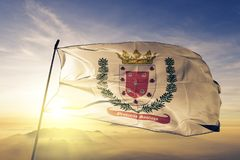 Santiago Province of Dominican Republic flag textile cloth fabric waving on the top sunrise mist fog. Beautiful royalty free stock photography