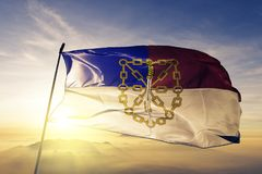 Santiago Rodriguez Province of Dominican Republic flag textile cloth fabric waving on the top sunrise mist fog. Beautiful royalty free stock images
