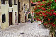 SANTILLANA DEL MAR, CANTABRIA, SPAIN, JULY 28, 2018: One of the beautiful narrow streets in Santillana del Mar, Cantabria, Spain. There is an old saying that royalty free stock photo