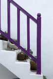 Santirini stairs. Purple staircase white wall Stock Images