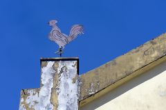 Weathercock on the tower of ancient church Stock Image