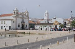 Santo Antonio Church in Lagos in Portuga. Tourist gather on a square in Lagos in Portugal with baroque Santo António Church to the left royalty free stock photos