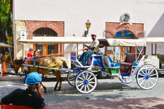 Santo Domingo, Δομινικανή Δημοκρατία Άτομο που οδηγεί μια horse-drawn μεταφορά στην αποικιακή ζώνη κοντά στο πάρκο του Columbus Στοκ εικόνες με δικαίωμα ελεύθερης χρήσης