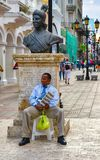 Santo Domingo, Dominican Republic. A man sitting at the base of Bartolomeo Colon statue, located in Conde street. b/n version Stock Photos