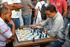 Santo Domingo, Dominican Republic. Men playing chess in Conde Street. Santo Domingo, Dominican Republic. Men playing chess in Conde Street Royalty Free Stock Photo