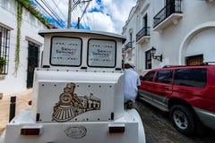 SANTO DOMINGO, DOMINICAN REPUBLIC - 1 NOVEMBER 2015: Cab in streets of Santo Domingo. SANTO DOMINGO, DOMINICAN REPUBLIC - NOVEMBER 1, 2015: White cab on road in Stock Image