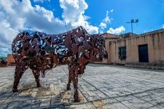 SANTO DOMINGO, DOMINICAN REPUBLIC- OCTOBER 30, 2015: Iron Bull artwork in Santo Domingo. SANTO DOMINGO, DOMINICAN REPUBLIC- OCTOBER 30, 2015: Exterior of the royalty free stock photos