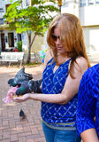 Santo Domingo, Dominican Republic. Woman feeds pigeons on Columbus Park, Colonial Zone of Santo Domingo. Santo Domingo, Dominican Republic. Woman feeds pigeons Royalty Free Stock Photos