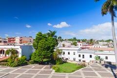 Santo Domingo. Plaza de Espana. Santo Domingo,  Dominican Republic. Plaza de Espana, street view with palms and houses Stock Image