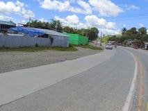 Santo Tomas - Carmen Road avec la belle formation de nuages photo libre de droits