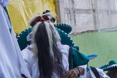 Santo Tomas Ocotepec, Oaxaca, Mexico, March 3, 2019: person dressed in white and mask of old man with eyebrows and big beardduring royalty free stock image