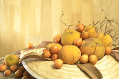 Santol  and Burmese grape  group weave hat background Royalty Free Stock Image