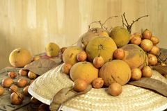 Santol  and Burmese grape  group weave hat background Royalty Free Stock Photos