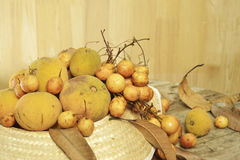 Santol  and Burmese grape  group weave hat background Stock Photography