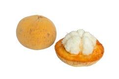 Santol fruit with peel isolated on white background Stock Photos