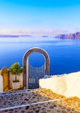 Santori. Gate into heaven, Cyclades, Greece. Santori gate facing the volcano in the sea Stock Image