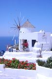 Santorin. A greek windmill and the sea Royalty Free Stock Photo