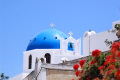 Santorin. A greek church with flowers Stock Photos