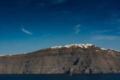 Santorini, Греция, взгляд от шлюпки круиза Стоковые Изображения RF