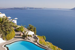 Santorini. Dream house set on a hill overlocking the sea Royalty Free Stock Photography