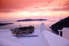 Santorini against sunset, Greece royalty free stock photos