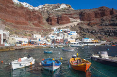 Santorini - The Amoudi harbor of Oia in evening light. Royalty Free Stock Images