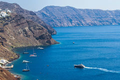 Santorini bay with many yacht in Greece Stock Photo