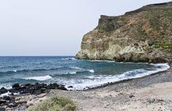 Santorini beach with black pumice stock image