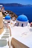 Santorini beauty. Stepped lane through the blue domes of Santorini, Greece Stock Photos