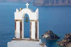 Santorini - The bell tower of typically little church in Oia Stock Photo
