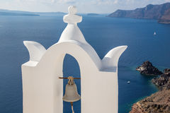 Santorini - The bell tower of typically little church in Oia Royalty Free Stock Photography