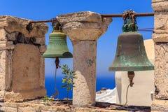 Santorini bells II. Detail of bells at Santorini village Oia stock images