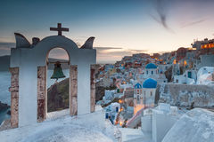 Santorini. Belltowers and domes of Santorini by dusk royalty free stock image