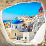 Santorini blue dome church look through the chimney Stock Images