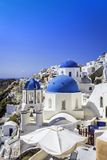 Santorini blue dome churches with copy space Royalty Free Stock Photo