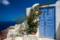 Santorini. Blue door in oia, santorini island, greece Royalty Free Stock Photography