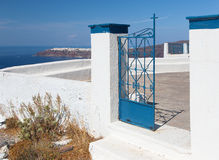 Santorini - blue gate of little church Theoskepasti in Imerovigli under the Skaros. Stock Image