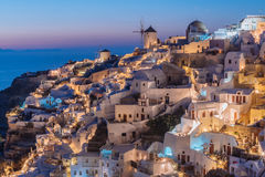 Santorini During Blue Hour. Santorini lighting up just after the sun went down Stock Photo